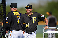 Pittsburgh Pirates Garth Brooks (7) talks with coach Tom Prince (14) during the teams first Spring Training practice on February 18, 2019 at Pirate City in Bradenton, Florida.  (Mike Janes/Four Seam Images)