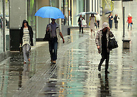 WEATHER PICTURE WALES<br /> Although sunshine and high temperatures had been forecast for most of the country, shoppers Wales needed umbrellas to go about  in Oxford Street, Swansea, Wales, UK. Tuesday 13 September 2016