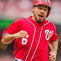 22 June 2014: Washington Nationals infielder Anthony Rendon comes home to score the first run of the game in the first inning against the Atlanta Braves at Nationals Park in Washington, DC. The Nationals defeated the Braves 4-1 to split their 4-game series and take sole possession of first place in the NL East. Mandatory Credit: Ed Wolfstein Photo *** RAW (NEF) Image File Available ***