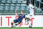 Fernando Recio of SC Kitchee (l) is chased by Auckland City Forward Joao Moreira (r) during the Nike Lunar New Year Cup 2017 match between SC Kitchee (HKG) and Auckland City FC (NZL) on January 31, 2017 in Hong Kong, Hong Kong. Photo by Marcio Rodrigo Machado / Power Sport Images
