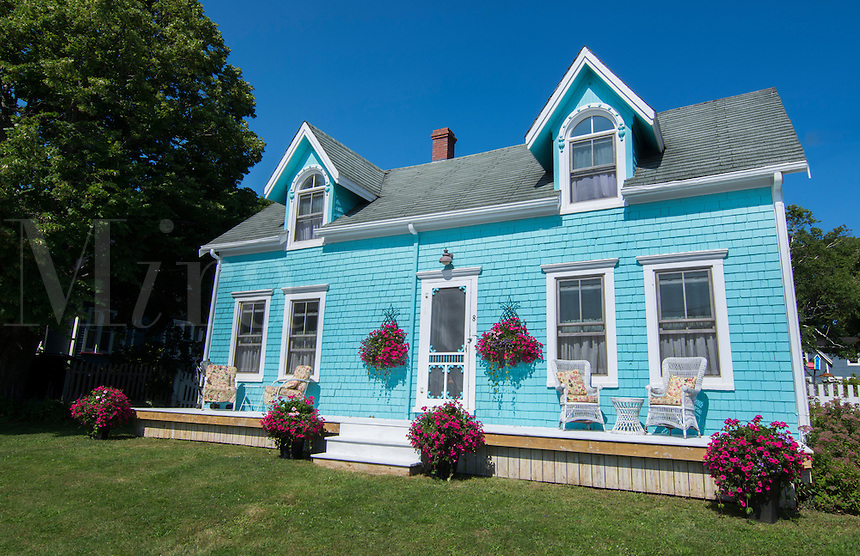 Canada Prince Edward Island, P.E.I. Victoria beautiful blue Victorian home with porch chairs and perfect Victorian home, Property Released
