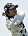 JEJU, SOUTH KOREA - APRIL 23:  Kim do-hoon of Korea tees off on the 9th hole during the Round Two of the Ballantine's Championship at Pinx Golf Club on April 23, 2010 in Jeju island, South Korea.  Photo by Victor Fraile / The Power of Sport Images