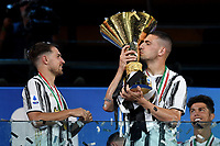 Aaron Ramsey and Merih Demiral of Juventus celebrate the victory of the italian championship at the end of the Serie A football match between Juventus FC and AS Roma at Juventus stadium in Turin (Italy), August 1st, 2020. Play resumes behind closed doors following the outbreak of the coronavirus disease. Photo Andrea Staccioli / Insidefoto