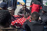 Calais 8-4-16 Scene in the Jungle Camp populated by refugees and migrants hoping to get to Britain. African men playing dominoes.