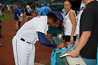 Jacksonville Jumbo Shrimp pitcher Sixto Sanchez (43) signs autographs before a Southern League game against the Mobile BayBears on May 28, 2019 at Baseball Grounds of Jacksonville in Jacksonville, Florida.  Mobile defeated Jacksonville 2-1.  (Mike Janes/Four Seam Images)