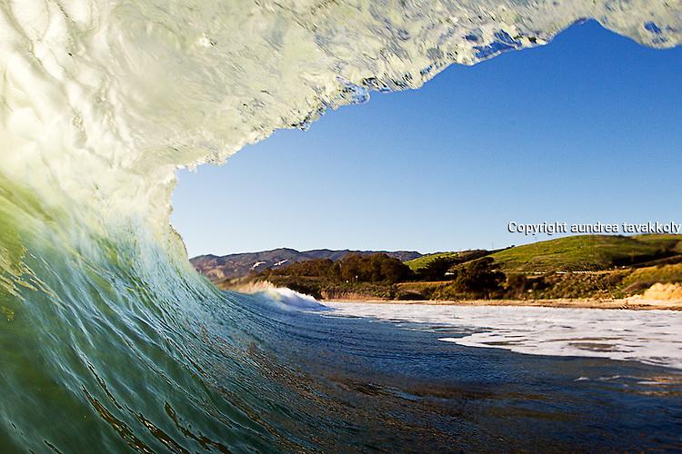 A surfers view of the gaviota coast through a wave