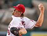 A determined Jered Weaver, pitcher for the Los Angeles Angels, prepares to deliver a curveball in a game against the Pittsburgh Pirates.