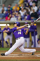 LSU Tigers third baseman Christian Ibarra #14 follows through on his swing against the Auburn Tigers in the NCAA baseball game on March 23, 2013 at Alex Box Stadium in Baton Rouge, Louisiana. LSU defeated Auburn 5-1. (Andrew Woolley/Four Seam Images).
