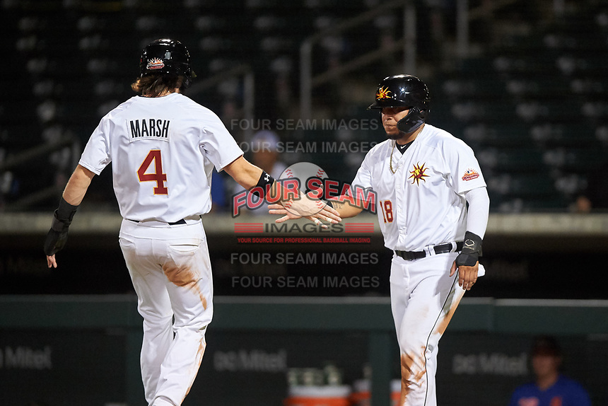 Mesa Solar Sox Isaac Paredes (18) congratulates Brandon Marsh (4) after a 2-RBI double by Miguel Amaya (not pictured) during an Arizona Fall League game against the Scottsdale Scorpions on September 18, 2019 at Sloan Park in Mesa, Arizona. Scottsdale defeated Mesa 5-4. (Zachary Lucy/Four Seam Images)