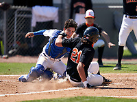 IMG Academy Ascenders catcher Charlie Lesch (8) attempts to tag Nolan Topper (21) sliding in safely at home during a JV game against the Lakeland Dreadnaughts on February 20, 2021 at IMG Academy in Bradenton, Florida.  (Mike Janes/Four Seam Images)