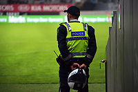A police officer watches the Super Rugby Tran-Tasman final between the Blues and Highlanders at Eden Park in Auckland, New Zealand on Saturday, 19 June 2021. Photo: Dave Lintott / lintottphoto.co.nz