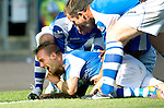 St Johnstone v Celtic....15.09.12      SPL  .Rowan Vine is mobbed by his team mates after scoring his goal which won the game for saints..Picture by Graeme Hart..Copyright Perthshire Picture Agency.Tel: 01738 623350  Mobile: 07990 594431
