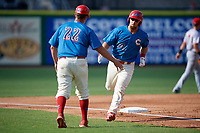 Clearwater Threshers manager Shawn Williams (22) congratulates designated hitter Austin Listi (34) after hitting a home run during a game against the Florida Fire Frogs on June 1, 2018 at Spectrum Field in Clearwater, Florida.  Clearwater defeated Florida 2-0 in a game that was started on May 19th but called in the fifth inning due to weather.  (Mike Janes/Four Seam Images)