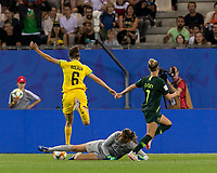 GRENOBLE, FRANCE - JUNE 18: Havana Solaun #6 of the Jamaican National Team beats sliding Lydia Williams #1 of the Australian National Team and scores during a game between Jamaica and Australia at Stade des Alpes on June 18, 2019 in Grenoble, France.