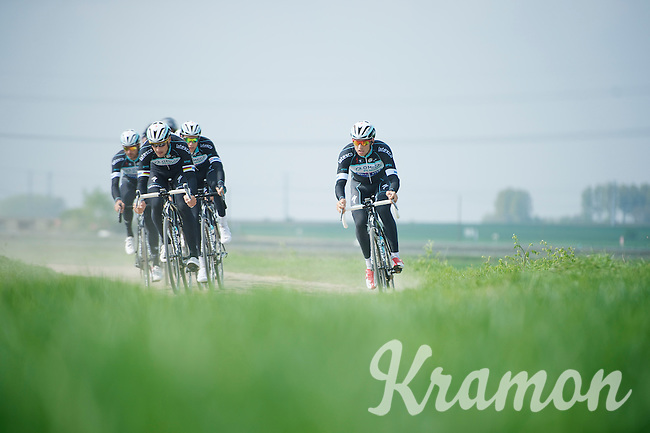 Tom Boonen (BEL/OPQS) leading the way over sector 12: Pavé d'Orchies. <br /> Zdenek Stybar (CZE/OPQS) coming from behind<br /> <br /> 2014 Paris-Roubaix reconnaissance