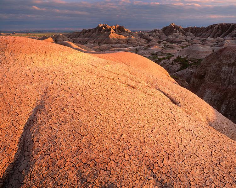 Sunset light on eroded formations in the Badlands; Badlands National Park, SD