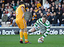 CELTIC'S KRIS COMMONS GOES OVER THE OUTSTRETCHED LEG OF MOTHERWELL'S STEVEN JENNINGS IN THE PENALTY BOX BUT REF CHARLIE RICHMOND WAVES PLAY ON.