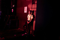 A magician from the Cape Town College of Magic waits backstage during a magic show at the Artscape Theatre.