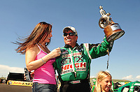 Jul. 24, 2011; Morrison, CO, USA: NHRA funny car driver John Force celebrates with wife Laurie Force after winning the Mile High Nationals at Bandimere Speedway. Mandatory Credit: Mark J. Rebilas-