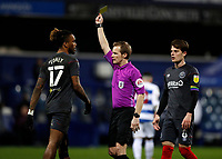 17th February 2021; The Kiyan Prince Foundation Stadium, London, England; English Football League Championship Football, Queen Park Rangers versus Brentford; Referee Gavin Ward giving a yellow card to Ivan Toney of Brentford
