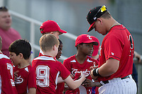 Corey Zangari (14) of the Kannapolis Intimidators signs autographs prior to the game against the Lakewood BlueClaws at Kannapolis Intimidators Stadium on May 7, 2016 in Kannapolis, North Carolina.  The Intimidators defeated the BlueClaws 12-3.  (Brian Westerholt/Four Seam Images)