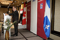 Montreal (Qc) CANADA -April 27 2009 - -Raymond Bachand, Quebec Finance Minister  thanks Jacques L Menard, CEO, Quebec division, Bank of Montreal (BMO) after he spoke at the Canadian Club of Montreal's podium on education and school drop out in Quebec.