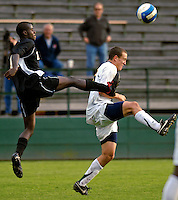 17 October 2007: The University of Maryland Retrievers' Shondell Busby (left), a Junior from Toronto, Ontario, battles the University of Vermont Catamounts' Justin Geibel (right), a Senior from Boxford, MA, during action at Historic Centennial Field in Burlington, Vermont. The Catamounts and Retrievers battled to a scoreless, double-overtime tie...Mandatory Photo Credit: Ed Wolfstein Photo