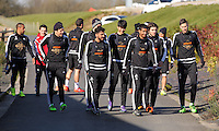 Pictured: Players walk to the training pitch Thursday 25 February<br /> Re: Swansea City FC training at Fairwood, near Swansea, Wales, UK, ahead of their game against Tottenham Hotspur.