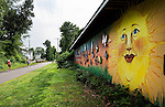 Southington, CT- 30 June 2015-063015CM01-   A mural lines the Farmington Canal Heritage Trail in Southington on Tuesday afternoon.  Walkers, runners and cyclists were out using the trail, which is part of the East Coast Greenway, stretching through 15 states.   Christopher Massa Republican-American