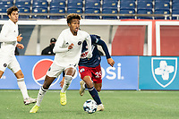 FOXBOROUGH, MA - OCTOBER 09: Jason Bucknor #22 of Fort Lauderdale CF pushes the ball forward during a game between Fort Lauderdale CF and New England Revolution II at Gillette Stadium on October 09, 2020 in Foxborough, Massachusetts.