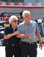 Apr 11, 2015; Las Vegas, NV, USA; NHRA top fuel driver Chris Karamesines (left) with Jim Head during qualifying for the Summitracing.com Nationals at The Strip at Las Vegas Motor Speedway. Mandatory Credit: Mark J. Rebilas-