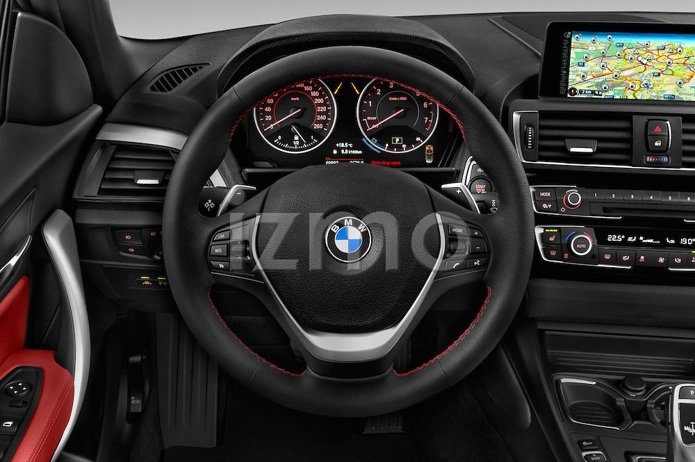 Car pictures of steering wheel view of a 2015 BMW 2-Series 230i 2 Door Convertible Steering Wheel