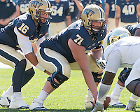 Pitt center Gabe Roberts (71) prepares to hike the ball to quarterback Chad Voytik (16). The Akron Zips Defeated the Pitt Panthers 21-10 at Heinz Field, Pittsburgh. Pennsylvania on September 27, 2014.