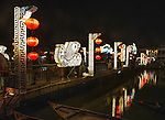 The pedestrian bridge connects the main part of Hoi An with a section of the town that forms an island in the Thu Bon River. It is decorated with fanciful fish shapes and is brightly lit at night.