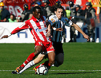 Lee Adi, left from Red Star Belgrade, in action against Partizan player CLEO, right,  during the Serbian League soccer match in Belgrade, Serbia, Saturday, October  24, 2010. (Srdjan Stevanovic/Starsportphoto.com)