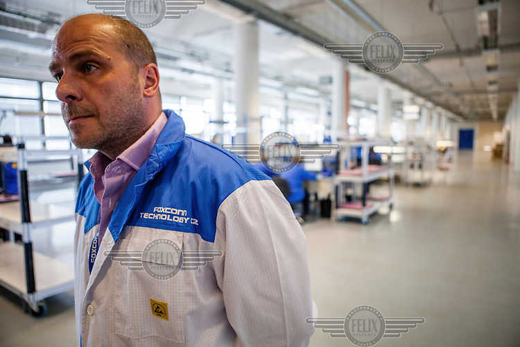 Patrick Blunsdon a Business Development Manager<br /> of the Foxconn Global Services Division on the factory floor at the Foxconn mobile repair centre where all work is done in an Electrostatic Discharge Protected Area (EPA).