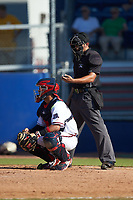 Home plate umpire Justin Juska checks his indicator as Danville Braves catcher Ricardo Rodriguez (49) looks on during the game against the Bristol Pirates at American Legion Post 325 Field on July 1, 2018 in Danville, Virginia. The Braves defeated the Pirates 3-2 in 10 innings. (Brian Westerholt/Four Seam Images)
