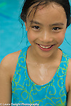 7 year old girl outside closeup portrait in bathing suit