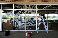 A member of V's Cleaning Service washes a window displaying the mason jar logo of the Columbia Fireflies on Sunday, April 3, 2016, as the club gets ready to open the new Spirit Communications Park in Columbia, South Carolina. The Class A South Atlantic League Mets affiliate moved this year from Savannah. (Tom Priddy/Four Seam Images)