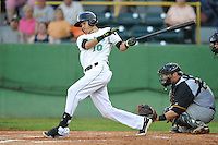 Luis Caballero #10 of the Clinton LumberKings swings against the South Bend Sliver Hawks at Ashford University Field on July 26, 2014 in Clinton, Iowa. The Sliver Hawks won 2-0.   (Dennis Hubbard/Four Seam Images)