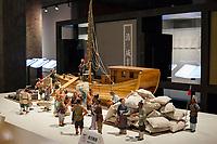 Suzhou, Jiangsu, China.  Exhibit Demonstrating Loading a Boat with Tiles for Shipping to Beijing.  Suzhou Museum of Imperial Kiln Brick.