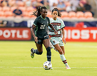 HOUSTON, TX - JUNE 13: Michelle Alozie #22 of Nigeria dribbles the ball during a game between Nigeria and Portugal at BBVA Stadium on June 13, 2021 in Houston, Texas.