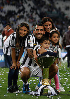Calcio, Serie A: Juventus vs Napoli. Torino, Juventus Stadium, 23 maggio 2015. <br /> Juventus' Carlos Tevez celebrates with his family the victory of the Scudetto at the end of the Italian Serie A football match between Juventus and Napoli at Turin's Juventus Stadium, 23 May 2015.<br /> UPDATE IMAGES PRESS/Isabella Bonotto