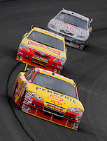 Feb 22, 2009; Fontana, CA, USA; NASCAR Sprint Cup Series driver Kevin Harvick leads Marcos Ambrose and Scott Speed during the Auto Club 500 at Auto Club Speedway. Mandatory Credit: Mark J. Rebilas-