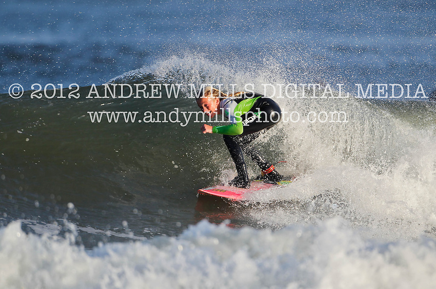 Kirsty Quigley Kamen surfs at Manasquan Inlet on Oct. 21, 2012