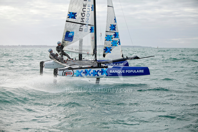 Armel Le Cléac'h and Kevin Escoffier from the Banque Populaire Sailing Team and the Flying Phantom.<br />The Flying Phantom is a new generation of foiling catamarans design by Martin Fisher.