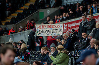Sunday  14th   December 2014 <br /> Pictured: A woman holds a Merry Christmas sign <br /> Re: Barclays Premier League Swansea City v Tottenham Hotspur  at the Liberty Stadium, Swansea, Wales,UK