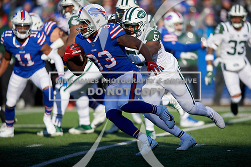 Buffalo Bills Chris Ivory (33) rushes up field as Brandon Copeland (51) gives chase during an NFL football game against the New York Jets, Sunday, December 9, 2018, in Orchard Park, N.Y.  (Mike Janes Photography)