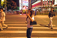 Ah Li, a 21 year-old female drug addict wanders in the street of Shenzhen, China.   Ah Li moved to Shenzhen from northern China.when just sixteen years old after the break-up of her family. She was tricked into prostitution and initially forced to take drugs until she became addicted and dependent on her gang bosses. She supports her drug addiction by prostitution.