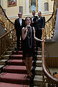 Brocket Hall, Hertfordshire, UK. 16.04.2021. The cast of THE SORROWS OF SATAN, a musical play by Luke Bateman and Michael Conley, pose on the grand staircase of Brocket Hall, where the production is being filmed for streaming. Directed by Adam Lenson, musical direction by Stefan Bednarczyk, produced by Alfred Taylor-Gaunt (Executive Producer) and Aisling Tara (Producer), with lighting design by Sam Waddington and Ben Jacobs, video design by Matt Powell, and costume and set design by Michael Conley. Picture shows: (front), Molly Lynch, (back, l to r) Stefan Bednarczyk, Michael Conley, Luke Bateman. Photograph © Jane Hobson.